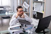 Overworked Businessman Holding Help Flag With Stack Of Folders On Desk poster