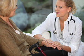 picture of medical assistant  - medical assistant taking care of senior woman - JPG