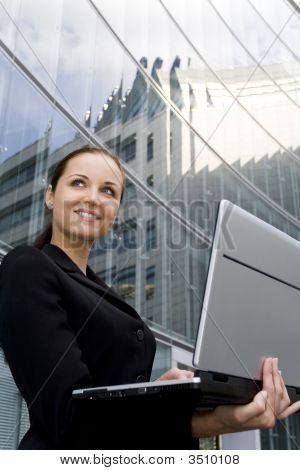 Businesswoman Using Laptop Outside Office
