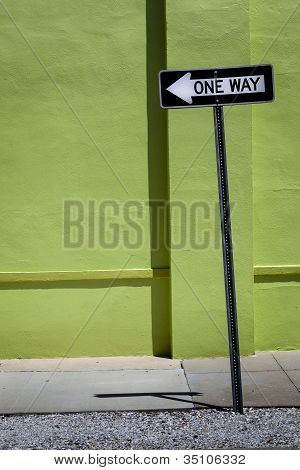 One Way Sign & Green Wall