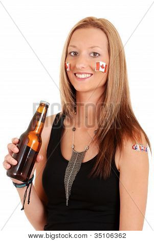 Young woman celebrating canada day with beer