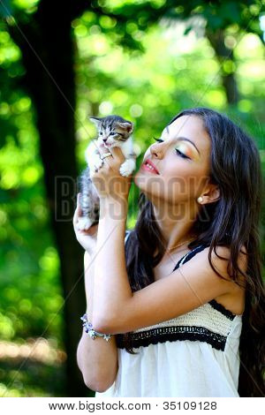 Pretty Young Caucasian Girl With Cute Little Kitten