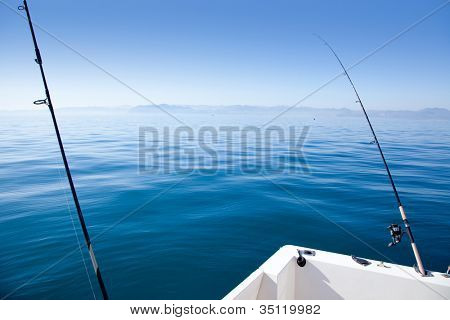 tranquil mediterranean sea with fishing boat rood and reel