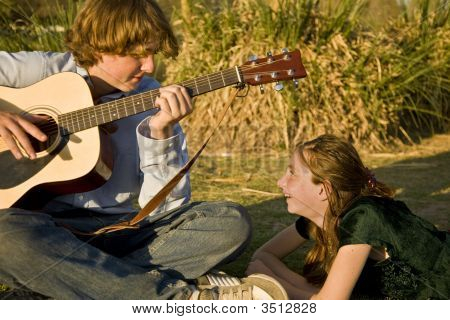 Brother And Sister Playing Music