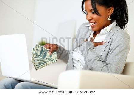 Ambitious Excited Young Woman With Money