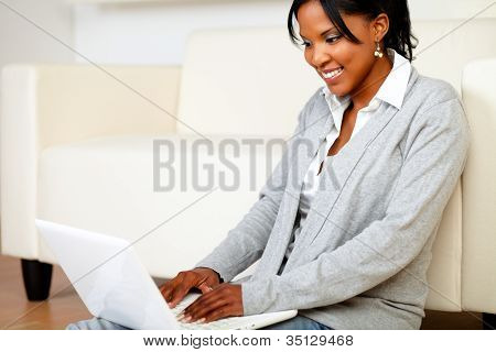 Smiling Young Woman Using Laptop