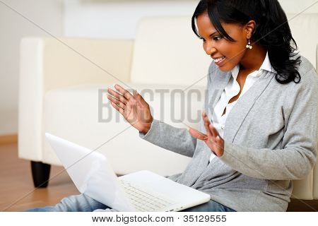Excited Stylish Woman Looking To Laptop Screen