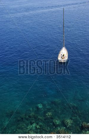 Sail Boat In Clear Water