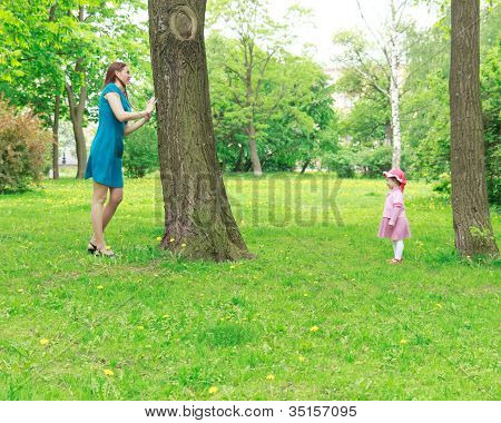 Mother And Girl Playing Hide-and-seek