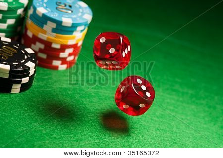 Rolling Red Dice On A Casino Table
