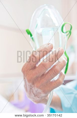 Person Holding A Oxygen Mask