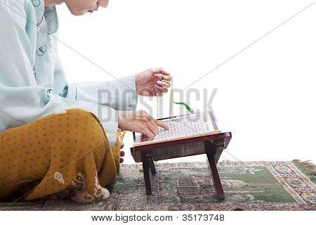 Asian Muslim Reading Koran In Ramadan