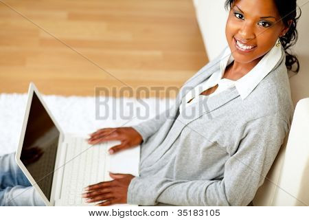 Young Girl Smiling At You With Her Laptop