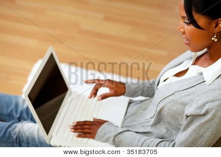Charming Young Woman Pointing To Laptop Screen