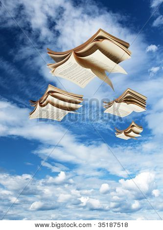 Four Open Books Flying Above