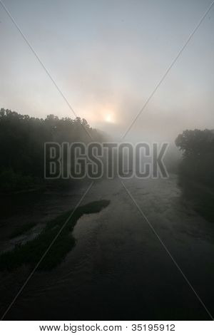 Foggy sunrise on river