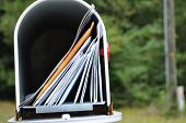 pic of mailbox  - a  rural  mailbox  chocked  full  of  mail - JPG