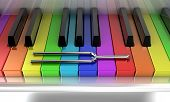 stock photo of tuning fork  - Illustration of a silver tuning fork on a multicoloured piano - JPG