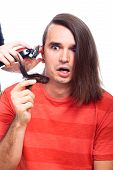 image of half-shaved hairstyle  - Shocked long haired man being shaved with hair trimmer isolated on white background - JPG