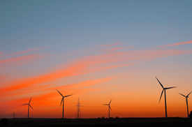 pic of electrical engineering  - Wind electric power plant on sunset sky - JPG