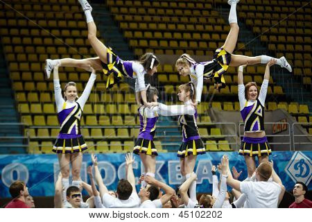 MOSCOW - MAR 24: Boys and girls from cheerleaders team perform stunt at Championship and Contests of Moscow in cheerleading at Palace of Sports Dynamo, March 24, 2012, Moscow, Russia.