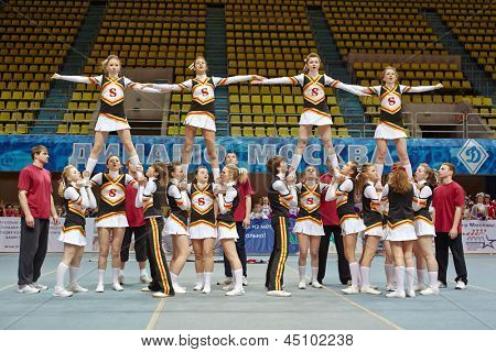 MOSCOW - MAR 24:  Cheerleaders team performs stunts at Championship and Contests of Moscow in cheerleading at Palace of Sports Dynamo, March 24, 2012, Moscow, Russia.