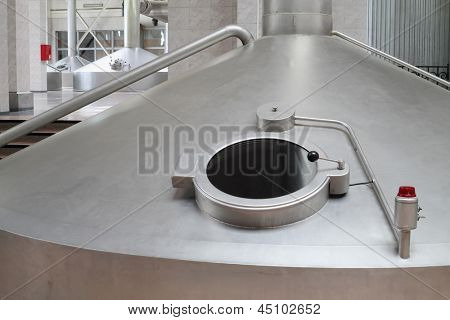 MOSCOW - MAY 31: Big cistern with hatch for beer in Ochakovo factory, on May 31, 2012 in Moscow, Russia. Ochakovo company has 18 enterprises.