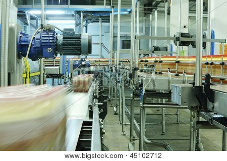 MOSCOW - MAY 16: Bottles and cases with bottles go on conveyors in Ochakovo factory, on May 16, 2012 in Moscow, Russia. Ochakovo - is one of most modern plants, not only in Russia but also in Europe.
