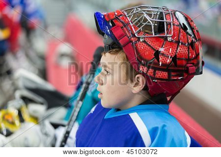 MOSCOW - APR 28: A young hockey player in stylish helmet on closing ceremony of championship season of 2011-2012 Ice Hockey for Sports School, junior teams on April 28, 2012, Sokolniki, Moscow, Russia