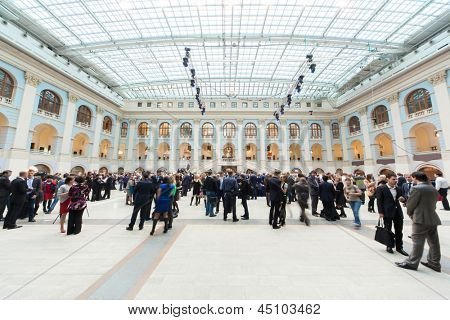 MOSCOW - APR 12: People walk in Gostini dvor before Ceremony of rewarding of winners of an award Brand of year of EFFIE 2011, on April 12, 2012 in Moscow, Russia