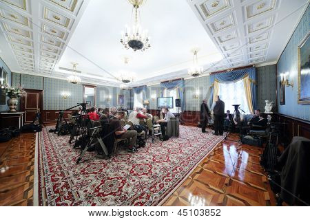 MOSCOW - APRIL 24: Newspersons sit in front of TV on Enlarged meeting of Council in Stuffed hall of guest annexe in Grand Kremlin Palace on April 24, 2012 in Moscow, Russia.