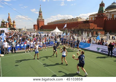 MOSCOW - MAY 26: Volleyball players train ahead of the game on VIII Forum Ready for Labor and Defense on May 26, 2012 in Red Square, Moscow, Russia.