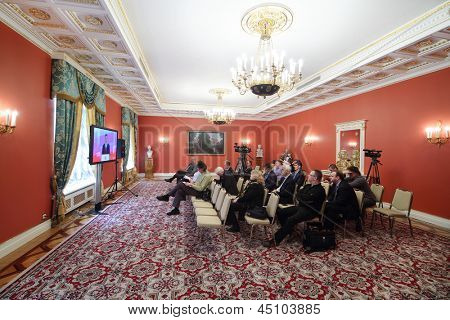 MOSCOW - APRIL 24: Newspapermen listen and write information on Enlarged meeting of Council in Grand Kremlin Palace on April 24, 2012 in Moscow, Russia.