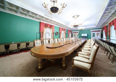 MOSCOW - APRIL 24: Long table in Green Hall of guest annexe in Grand Kremlin Palace on April 24, 2012 in Moscow, Russia. Grand Kremlin Palace was built in 1838-1849 by order of Emperor Nicholas I.