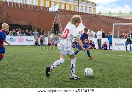 MOSCOW - MAY 26: Young players are playing soccer on VIII Forum Ready for Labor and Defense on May 26, 2012 in Red Square, Moscow, Russia.