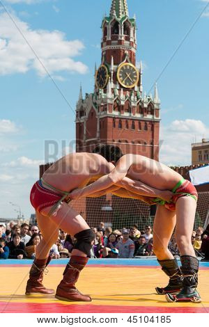 MOSCOW - MAY 26: The fighters are locked in Mongolian wrestling on Nation-wide 2012 Games SPORTS GENERATIONS dedicated to the 175th anniversary of Russian railways, May 26, 2012 in Moscow, Russia.