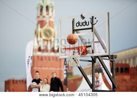 MOSCOW - MAY 27: Ball over basket in game during Dudu Streetbasket fest on Red Square, May 27, 2012, Moscow, Russia. Streetbasket fest takes place within 8th sports forum GTO.