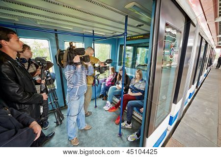 MOSCOW - MAY 14: Passengers and journalists in carriage of Moscow monorail system at station Sergei Eisenstein  Street, May 14, 2012, Moscow, Russia.