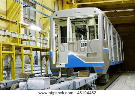 MYTISHCHI - APR 18: To-be assembled wagon and  mounted wheels in shop floor at  Mytishchi Metrovagonmash factory, April 18, 2012, Mytishchi, Russia. The plant is famous for creating subway cars.