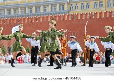 MOSCOW - MAY 27: Children collective performance on Red Square during 8-th sports forum GTO, May 27, 2012, Moscow, Russia. More than 50 teams perform their sports program in forum.