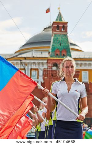 MOSCOW - MAY 27: Girls with flags of Russian Federation on Red Square during 8-th sports forum GTO, May 27, 2012, Moscow, Russia. More than 50 teams perform their sports program in forum.
