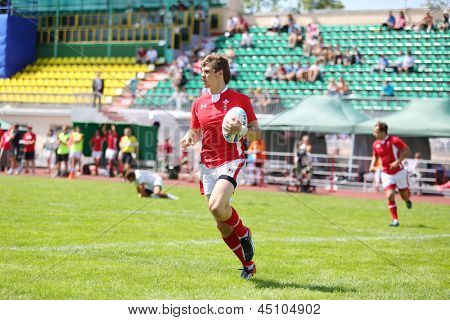 MOSCOW - JUNE 30: Rugby player from Welsh runs with ball on second stage of European championship on rugby-7 in sports complex Luzhniki, on June 30, 2012 in Moscow, Russia.