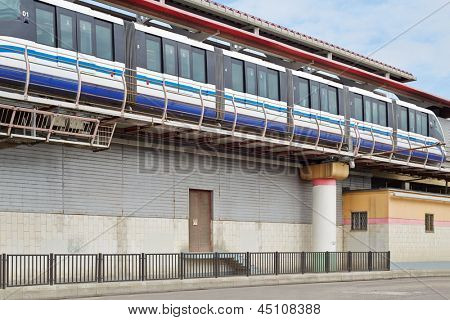 Monorail train on railway, view from below
