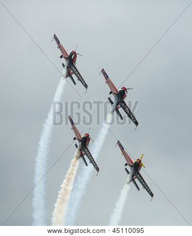 LANGKAWI, MALAYSIA - MAR 26: Malaysia Aerobatic Team X330L Krisakti performing during on LIMA'13 - Langkawi International Maritime & Aerospace Exhibition on Mar 26, 2013 in Langkawi, Malaysia.