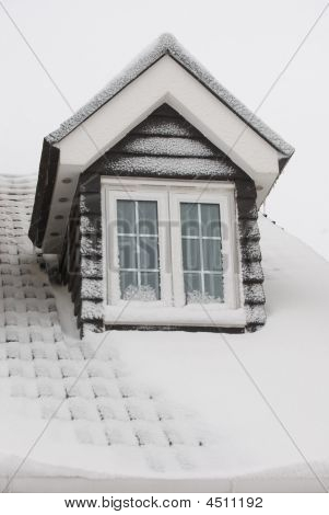 A Roof Covered In Snow