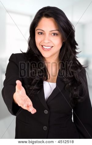 Hispanic Businesswoman Offering Handshake