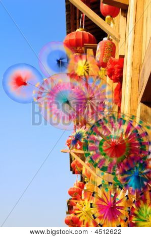 Turning Colorful Rainbow Toy Pinwheels And Red Lantern