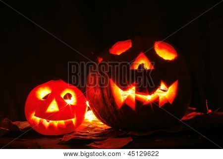 Halloween Pumkins On The Black Background