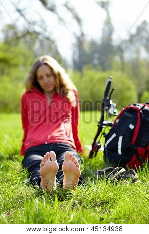 Girl Cyclist Barefoot Enjoying Relaxation