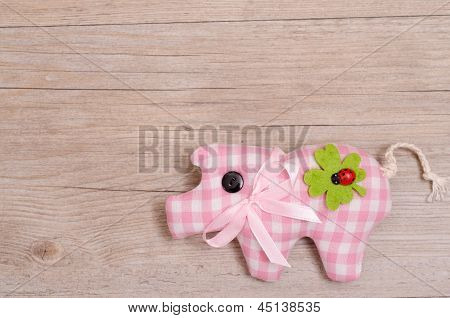 Pink Checkered Pig On Wooden Board